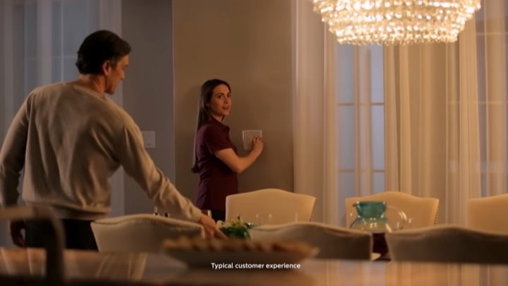 Lady using a dimmer switch to change the ambiance in a room